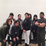 Ayomi Yoshida with members of her installation team