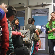 Kathryn Lozada '12 says goodbye to energized students after programming ends for the day.