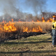 Jared Beck '14 working on a controlled burn of the Arboretum prairie.